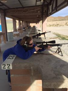 Woman practicing shooting
