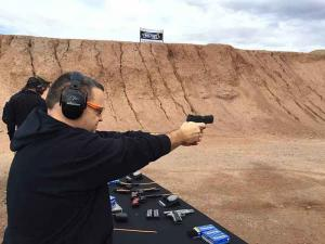 Instructor shooting a handgun